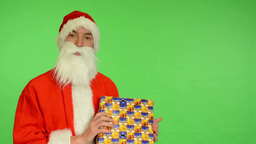 santa claus - green screen - studio - Santa Claus holding a gift and smiling Footage