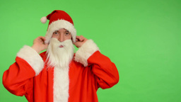 santa claus - green screen - studio - Santa Claus putting on a Christmas hat Footage
