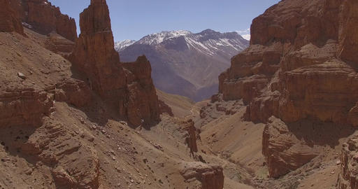 Red Canyon and Snow-Capped Mountains Footage