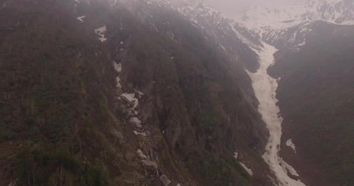 Flying Past Snow-Capped Mountains Footage