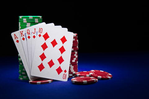 The best poker hand, royal flush with stuck of chips Photo