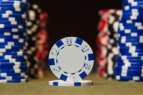 Closeup of poker chips on red felt card table surface Photo