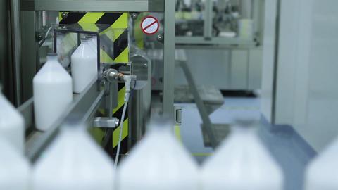Robotized Machine packaging Bottles Footage
