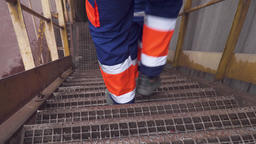feet of workers descending the stairs Stock Video Footage