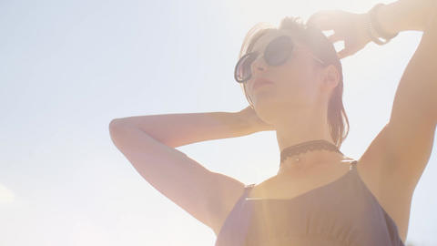 Portrait of the young girl posing in sunglasses in sun lights Footage