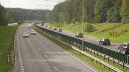 Cars running on highway down street. Four lanes two direction. Vilnius transport Footage