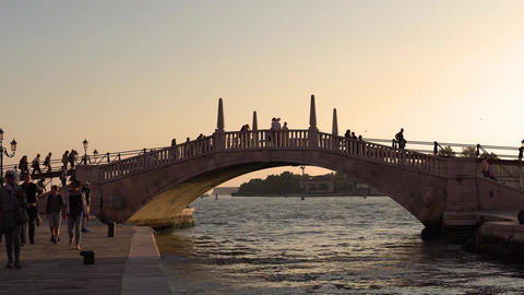 VENICE, ITALY - OCTOBER, 2017: Tourists walking the streets of Venice. Evening Live Action