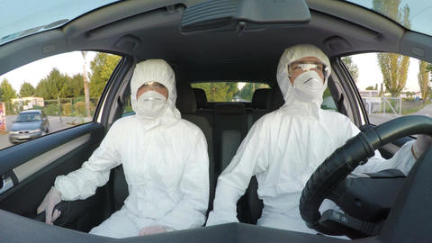 Engineers in hazmat suits driving to their rescue mission Footage