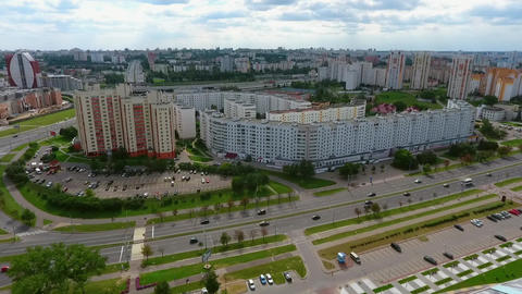 Houses in the city, housing area and highway with moving cars aerial Footage