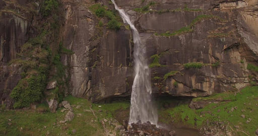 Majestic Waterfall Pours Down Cliffside Footage