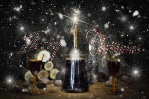 Merry Christmas Sign With Red Wine Vintage Bottle and Glasses Resting On Wooden Fotografía