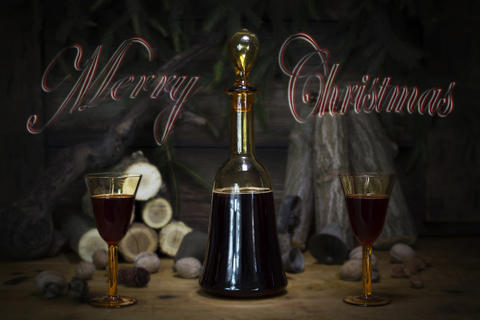 Merry Christmas Sign With Red Wine Vintage Bottle and Glasses Resting On Wooden Foto