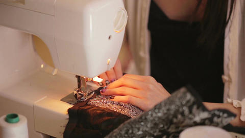 Fashion Designer sewing CU on machine and hands Footage