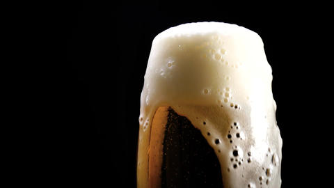 A lager beer is poured into a glass in close up Live Action
