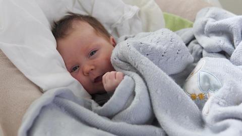 Cute newborn baby in crib Footage