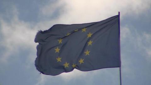 EU Flag Flies Against the Sky, against the Sunny Sky, the European Union Live Action