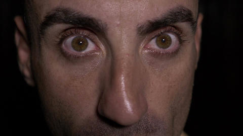 Close up with eyes of man opening wide and showing surprised expression Footage