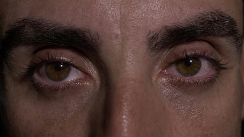 Close up with eyes of man showing surprise Live Action