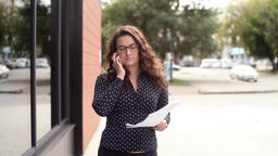 Beautiful attractive business woman picks up documents after hearing the good Footage