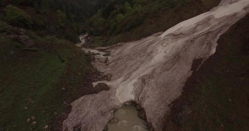 Creek Passes Under Large Rock Footage