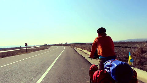 Cycling traveler on the highway Live Action