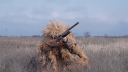 slo-mo shooter in camouflage clothing silvan shoots a gun Footage