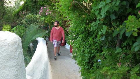 single man walking narrow streets of plaka, athens, greece, 4k Footage