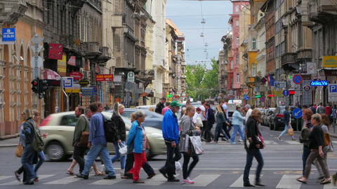 BUDAPEST - HUNGARY, AUGUST 2015: pedestrians crossing streets Footage