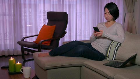 Japanese Woman People Girl On Couch With Smartphone For Internet Live Action