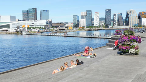 OSLO - NORWAY, AUGUST 2015: people sunbathing swimming opera house Footage