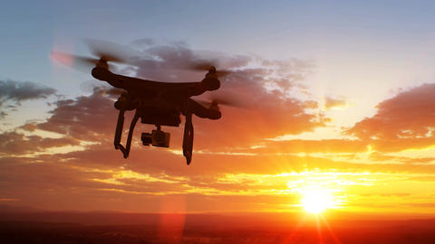 Quadcopter Flying Away to the Beautiful Sunset Scene. Modern Electronics Concept Animation