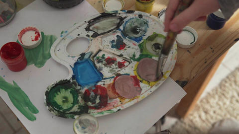 Child's hand mixes colors Footage