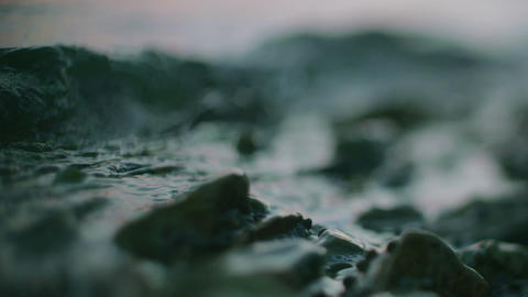 Blue Water Surface Waving Over Stone ビデオ