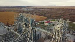 Flight under granaries and elevators or oil storage on autumn background Live Action