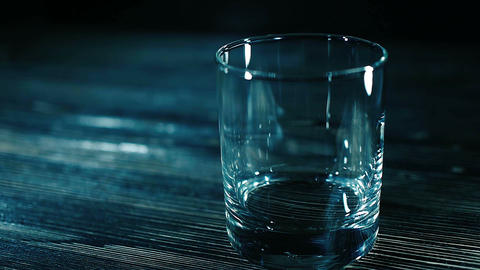 Whiskey pouring into a glass with ice Footage