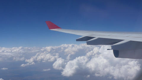 Airplane Wing Flying Over Clouds Footage