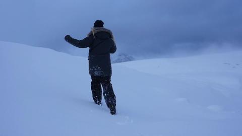 Woman Runs Up Snowy Hill Footage