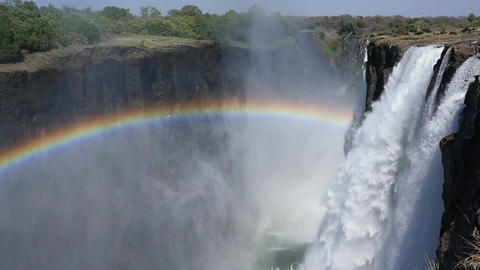 Bright Rainbow to the Left of Waterfall Footage