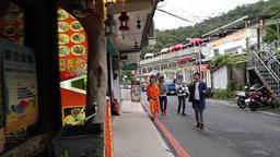 Tourists eating ice cream in the tea mountain village of Maokong Taipei Taiwan Footage