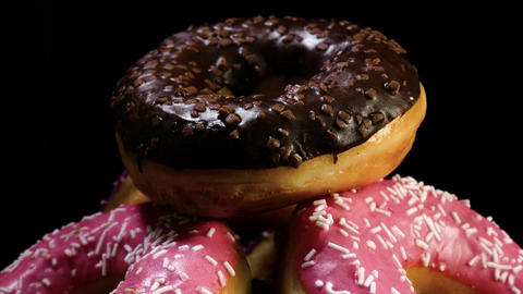 Close up of freshly baked donuts with glaze Footage