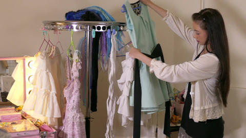 Asian American fashion designer sorting clothes slider move Footage