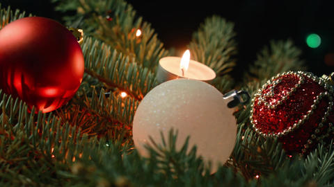 beautiful Christmas tree with balls and candles on the background of blurred Footage