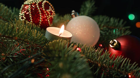 Christmas decoration with candles over dark background Footage