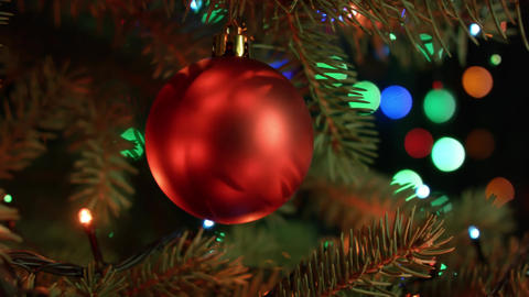 Christmas and new year decoration. Christmas tree decorations red ball with Footage