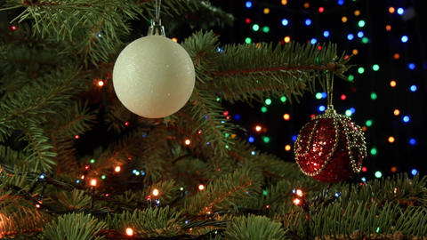Christmas decoration balls hanging on Christmas tree on the background lights Footage