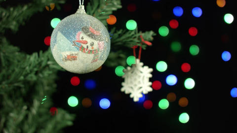 Christmas decoration ball and snow on the tree on the background of blurred Footage