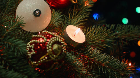 Christmas decorations on the Christmas tree with candles on a background Footage