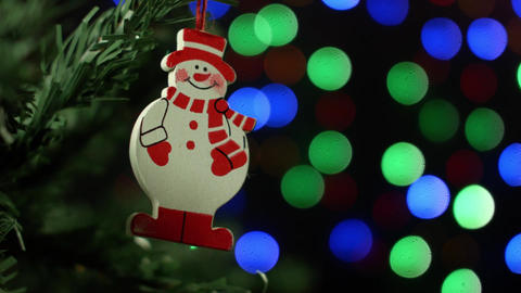 Christmas background with Christmas tree and snowman on background of blurred Footage