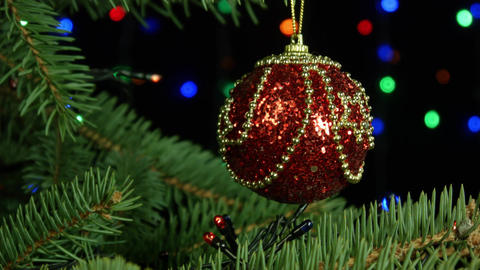 Merry Christmas and Happy New Year beautiful red ball hanging on tree on a Footage