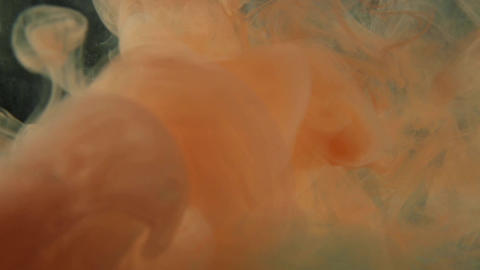 Light orange billowing ink cloud background Footage